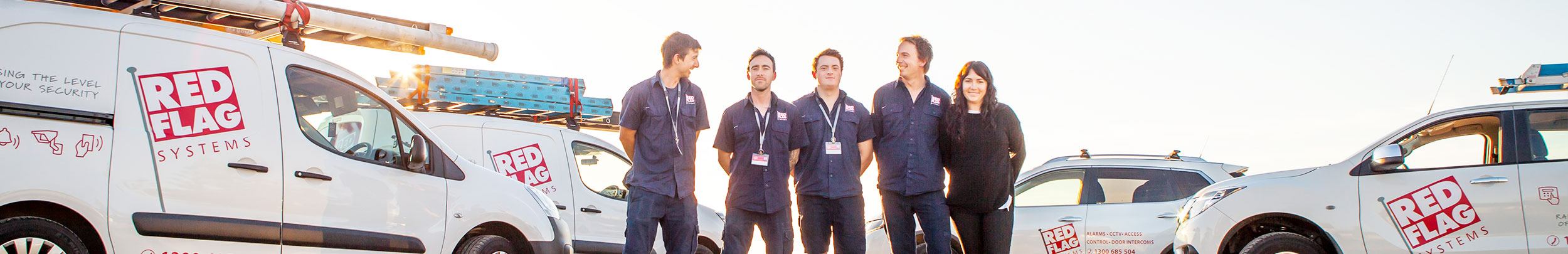 home and commercial security systems. Photo of the team at Red Flag Systems